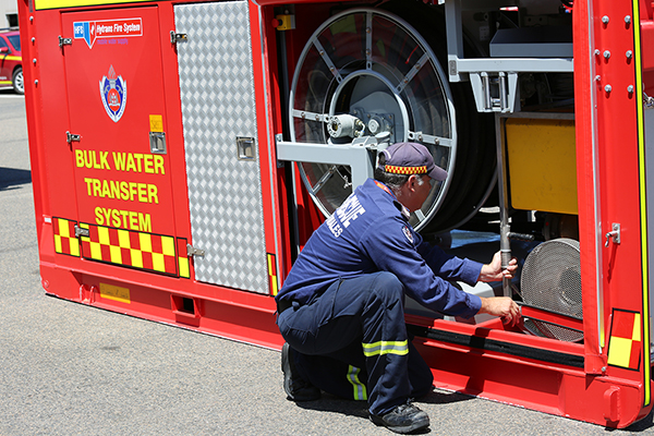Sydney water pump trucked in to douse recycling centre fire